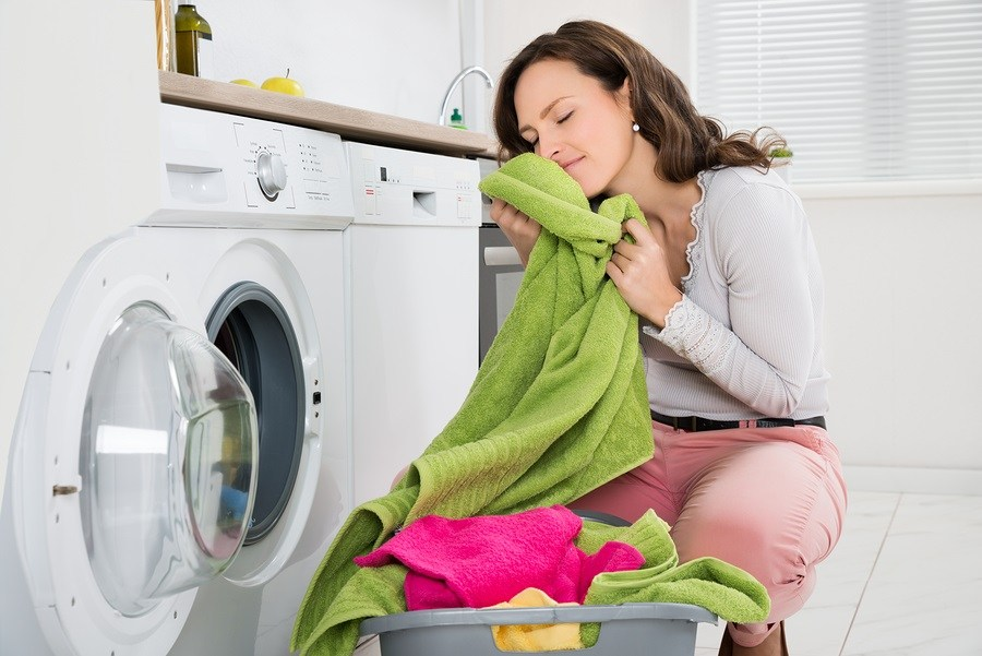 Woman-With-Clothes-Near-Washer-Dryer.jpg